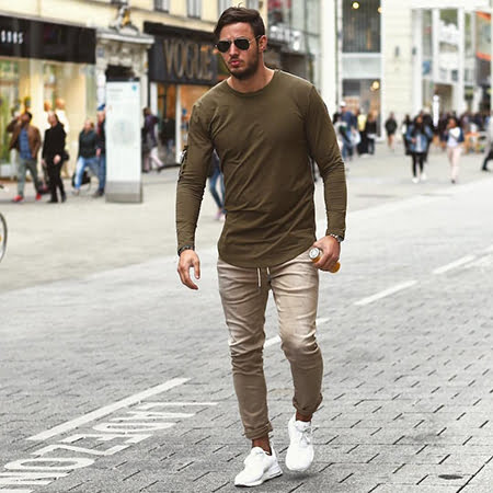 A solid colored shirt with or without a blazer and beige chino with white  sneakers looks absolutely urbane. 6bfb7f3ac3